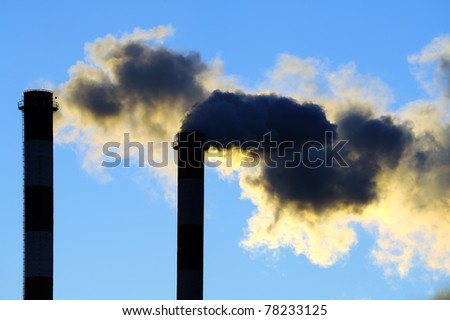Dangerous toxic clouds from industrial chimneys, pollution concept