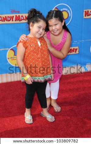 Daniella Baltodano and Madison De La Garza at the Los Angeles Premiere of \'Handy Manny Motorcycle Adventure\'. Arclight Hollywood, Hollywood, CA. 09-26-09