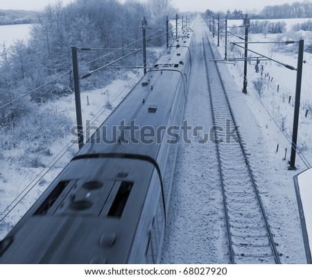 Danish intercity train on a cold December day in the countryside.