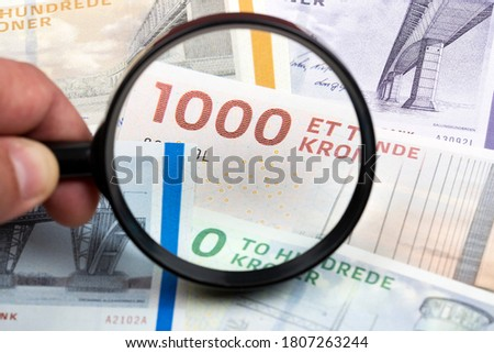 Danish money in a magnifying glass a business background Foto stock ©