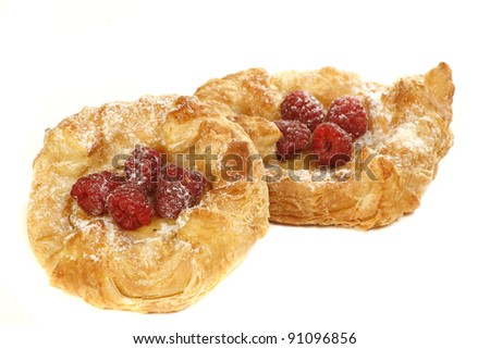 danish pastries with raspberries on a white background