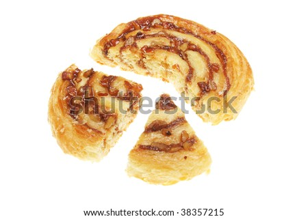 Danish pastry cut in sections isolated on white