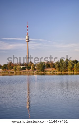 Danube Tower in Vienna city, Austria with water reflection