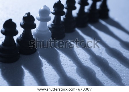 Dare to be different - A single white pawn among black pawns.