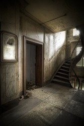 Dare to go up the stairs? A creepy hallway in a moody atmosphere.