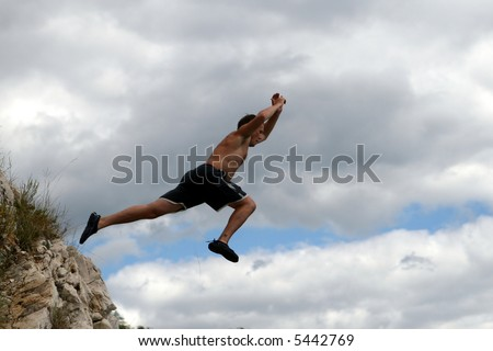 Dare To Take Off  A young man jumps from a cliff into the sea!