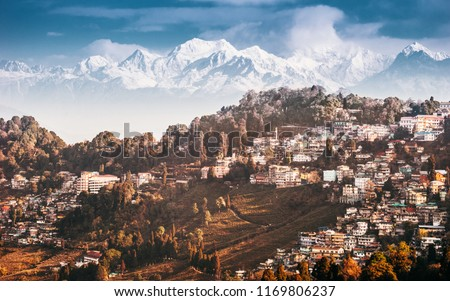 Darjeeling and Kangchenjunga on the background. Kanchenjunga, is the third highest mountain in the world. Beautiful Himalayan landscape near Nepal and Sikkim. Indian Himalayas.
