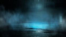 Dark abstract background. Empty dark street background at night. Spotlight reflects on the asphalt, blurry night lights. Smoke, fog.