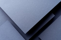Dark abstract background inspired by material design using cardboard and paper