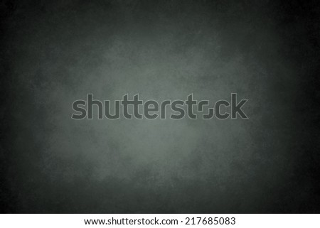 dark abstract texture or background with black vignette borders