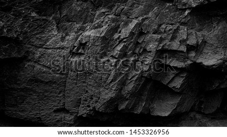 Dark Aged Shabby Cliff Face And Divided By Huge Cracks And Layers. Coarse, Rough Gray Stone Or Rock Texture Of Mountains, Background And Copy Space For Text On Theme Geology And Mountaineering.