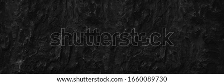 Dark aged shabby cliff face volcanic hillside. Coarse, rough gray volcanic stone or rock texture of mountains, background and copy space for text on theme geology and volcanic eruption study. Photo stock ©