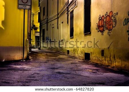 dark alley at night, narrow dirty corner of decadent old town, graffiti on grunge wall