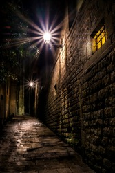 Dark alley in the city center of Barcelona