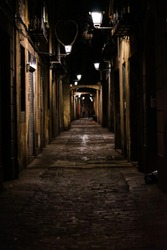 dark alley way during the evening in Barcelona Spain.