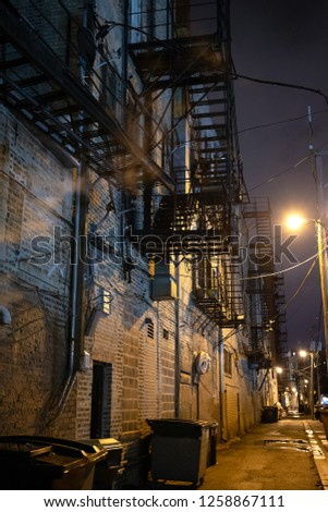Dark and eerie downtown urban city alley at night