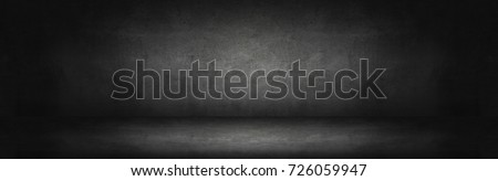 Photo of  dark and gray abstract  cement wall and studio room gradient background