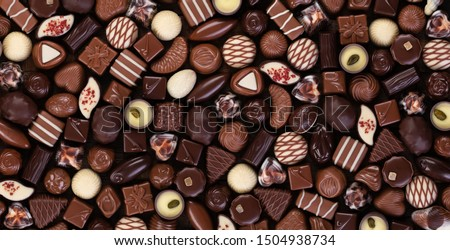 dark and milk chocolate candies, confectionery food background.