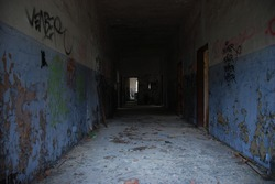 Dark and scary corridor of abandoned decay building, urbex