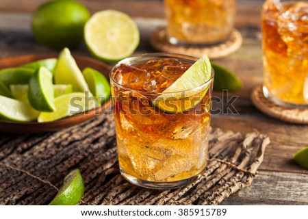 Dark and Stormy Rum Cocktail with Lime and Ginger Beer Stok fotoğraf ©