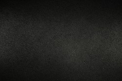Dark asphalt texture for the background. Rough surface. Abstract backdrop. Raster image.