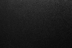 dark background of hammered powder paint coating on flat sheet steel surface