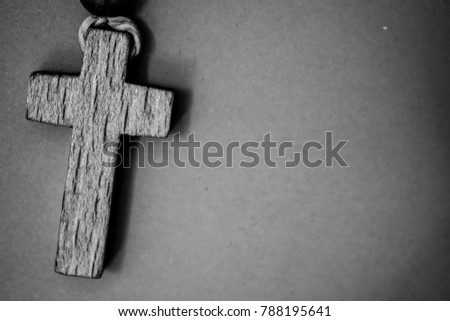 Dark background with a rosary cross, #788195641