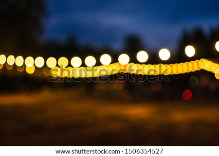 Dark background with blurry spots of light. Abstract blur. Bokeh lights blurry.