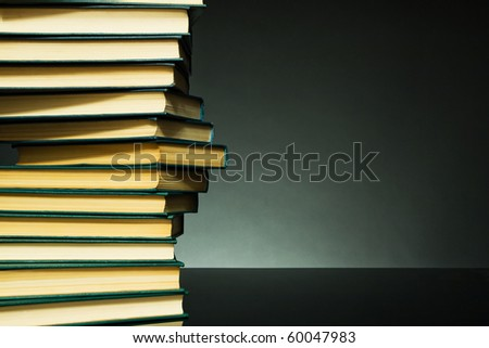Dark background with books in the form of DNA chain for any design project