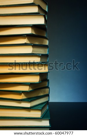 Dark background with books like a wall for any design project