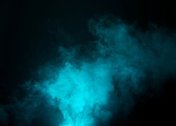 Dark background with cyan, blue fog floating in the air.