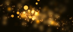 Dark background with luminous golden light effects. Horizontal background with blur bokeh effects for christmas time. Special occasion concept with space for text.