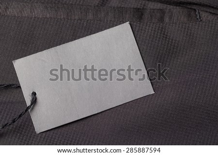 Dark background with paper pants label/Pants label