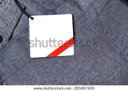 Dark background with white paper pants label/Pants label.