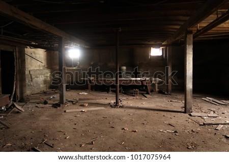Dark basement of an abandoned building. Natural light.                                 Foto stock ©