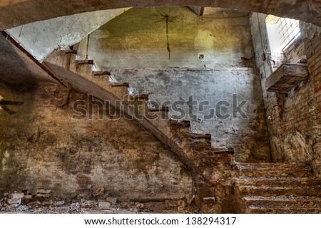 dark basement with stairs and window of an old abandoned country house