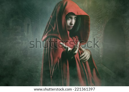 Dark beautiful woman in a mysterious stone village . Fantasy and halloween concept