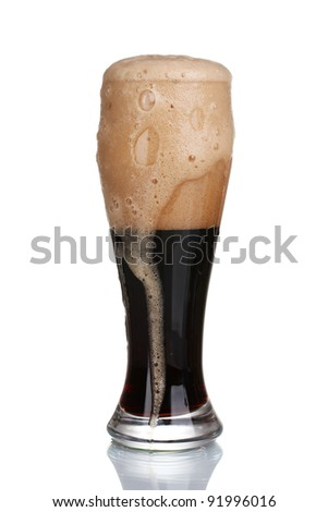 dark beer in a glass isolated on white