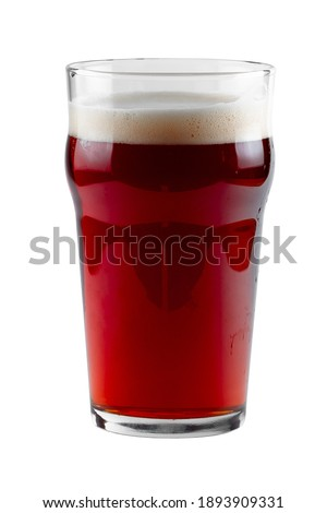 Dark beer in a glass - Nonic. Glass isolated on white with clipping path. Stock photo ©