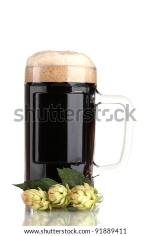 dark beer in a mug and green hop isolated on white