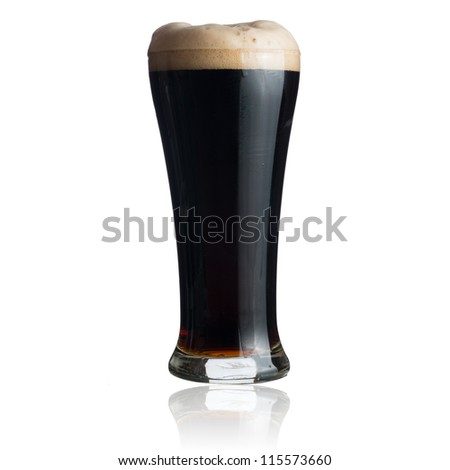 Dark beer in glass isolated on white