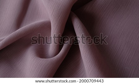 Dark beige color viscose fabric texture seamless with beautiful closeup detail fabric. Luxury textile pattern with soft and delicate material, sometimes this fabric is called cornskin fabric.