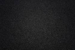 Dark black asphalt surface, background