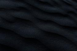 Dark, black, blue abstract sand pattern. Texture background image.