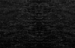 Dark black brick wall Is the background of the room that has textures Of old antique plaster grunge