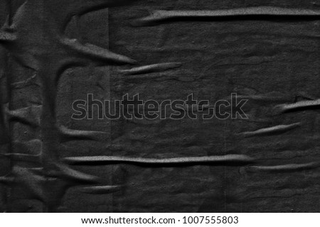 Dark black grey creased crumpled paper background surface old torn ripped posters scary grunge texture backdrop