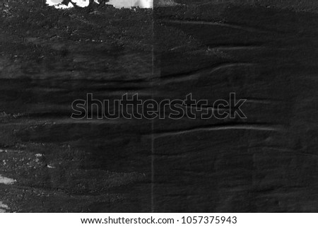 Dark black grey paper background creased crumpled surface old torn ripped posters placard grunge textures   #1057375943