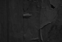 Dark black grey paper background creased crumpled surface / Old torn ripped posters scary grunge textures backdrop