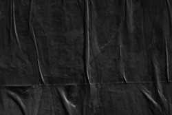 Dark black grey paper background creased crumpled surface old torn ripped posters scary grunge textures