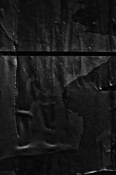 Dark black paper background creased crumpled surface / Old torn ripped posters scary grunge textures
